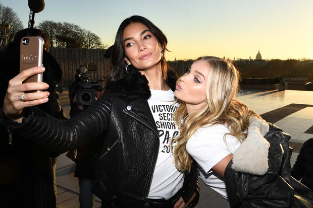 PARIS, FRANCE - NOVEMBER 29: Lily Aldridge and Elsa Hosk take a selfie in front of the Eiffel Tower prior the 2016 Victoria's Secret Fashion Show on November 29, 2016 in Paris, France. (Photo by Dimitrios Kambouris/Getty Images for Victoria's Secret)